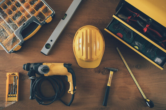Construction worker helmet, drill machine, level, meter and other equipment