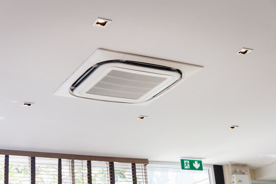 Modern ceiling mounted cassette type air conditioning system in coffee shop