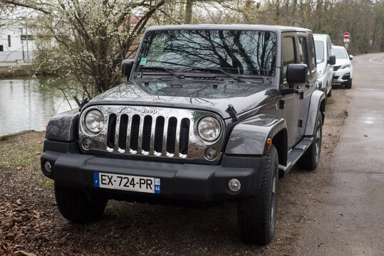 Mulhouse - France - 5 March 2021 - Front view of black Jeep wrangler parked in the street