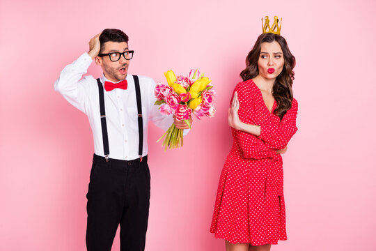 Photo of young gentleman present flower arrogant girl show no deny reject sign wear golden crown isolated over pastel color background