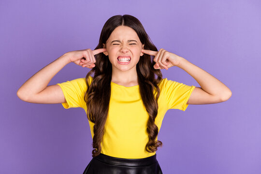 Portrait of nice stressed brunette hairdo girl cover ears wear yellow t-shirt isolated on vivid lilac color background