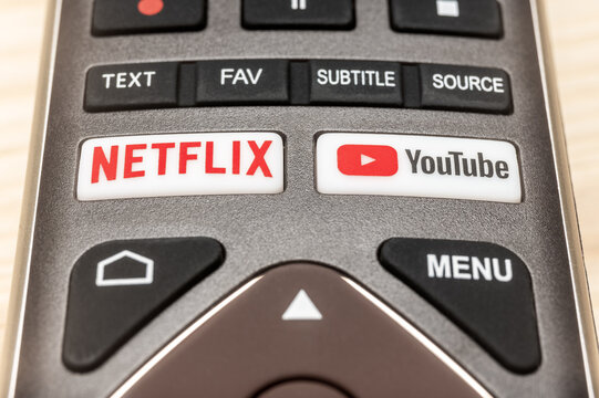 MOSCOW, RUSSIA - 6 MAR, 2021: Youtube and Netflix buttons on remote. Android television remote with Netflix and Youtube buttons