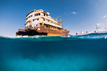 Telamon wreck ship in blue ocean. Split view. Lanzarote