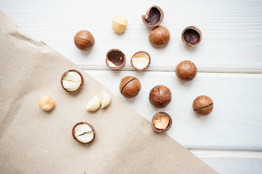 macadamia nuts on a white wooden background