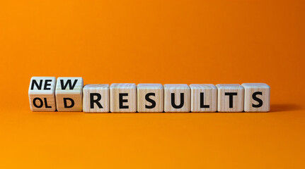 New vs old results symbol. Turned wooden cubes and changed words 'old results' to 'new results'. Beautiful orange background. Business, new or old results concept. Copy space.