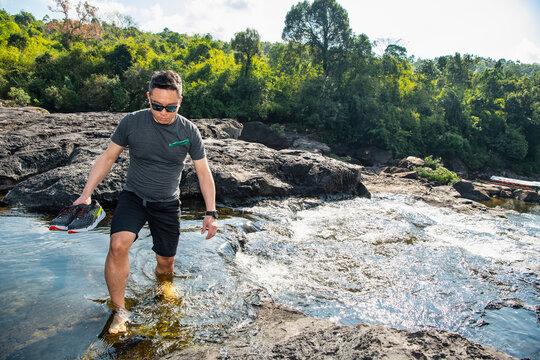 Mature man exploring Tatai river, Sihanoukville Province, Kampot, Cambodia