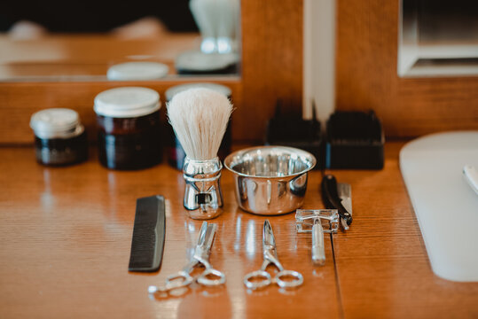 Hairdressing and shaving tools on table
