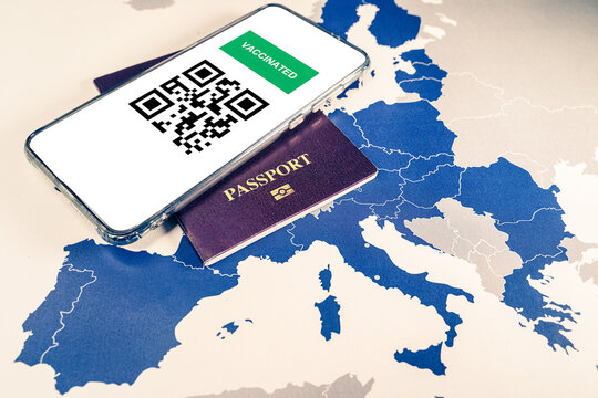 Digital green passport with QR code on a smartphone over an EU map.The European Union will propose issuing a certificate called a Digital Green Pass