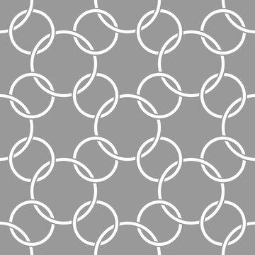 Vector geometric seamless pattern. Modern geometric background. A lattice of rings.