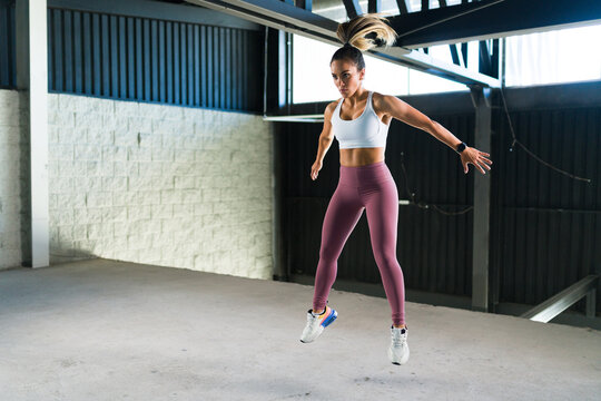 Active woman exercising in a high-intensity interval training
