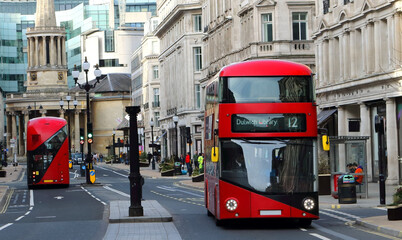 Classic Red bus on the street of central london. February 2021