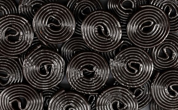 Black licorice rolls. Food background and texture.Top view.
