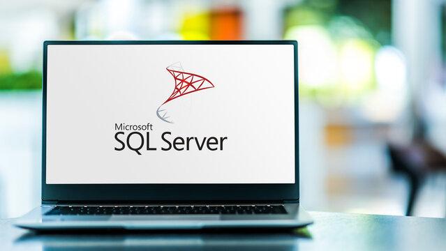 Laptop computer displaying logo of Microsoft SQL Server