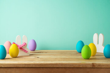 Wooden table with Easter eggs. Background for product display mock up.