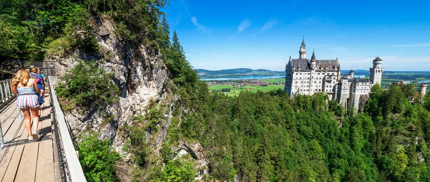 View of famous and amazing Neuschwanstein Castle, near Füssen, Bavaria, Germany, seen from the Marienbrücke (Mary's Bridge), a pedestrian bridge built over a cliff