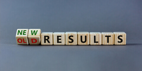 New vs old results symbol. Turned the wooden cube and changed words 'old results' to 'new results'. Beautiful grey background. Business, new or old results concept. Copy space.