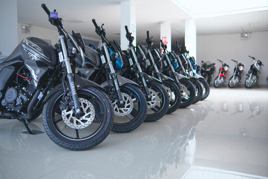 Motorcycles in the showroom Yamaha shop. New motorbikes and accessories in motorcycle store.