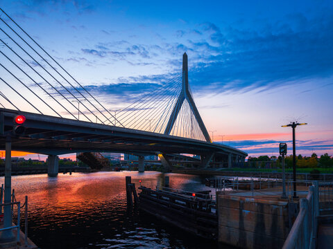 Sunset Cityscape of Boston with Zakim Bridge and Reflections on Charles River