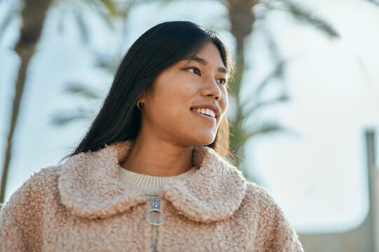 Young asian woman smiling happy standing at the city.