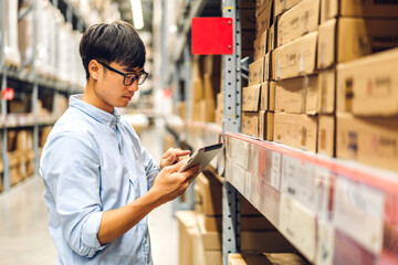 Portrait of smiling asian engineer foreman in helmets man order details checking goods and supplies on shelves with goods background in warehouse.logistic and business export - fototapety na wymiar