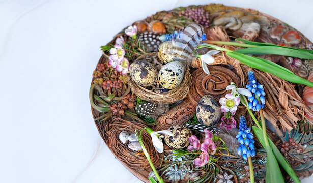 Wiccan Altar for spring Ostara sabbath. wheel of the year with flowers, feathers and eggs. Esoteric Ritual for pagan holiday. Magical Spring equinox