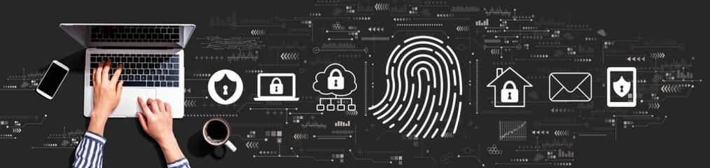 Fototapeta Fingerprint scanning theme with person using a laptop computer