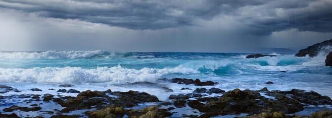 Obraz Sea coast with dark rain clouds and stormy sea. - fototapety do salonu