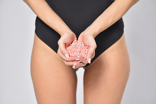 Young woman holding depilation wax in hands, body care and femininity concept