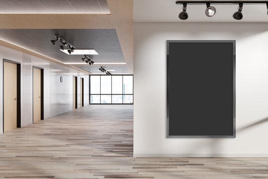 Black vertical frame Mockup hanging on wall. Mock up of a billboard in modern wooden office interior 3D rendering