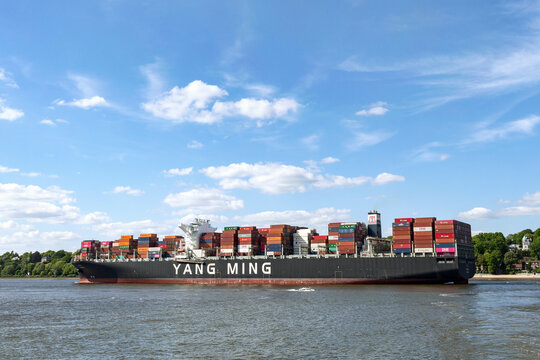 Container ship Yang Ming on the river Elbe in Hamburg, Germany