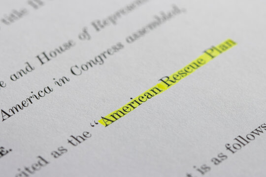 Closeup of the documents of the American Rescue Plan Act of 2021, an economic stimulus package proposed to speed up the recovery from the economic and health effects of the pandemic and the recession.