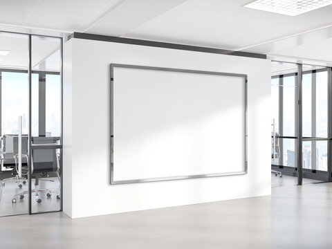 Black horizonal frame Mockup hanging on wall. Mock up of a billboard in modern concrete office interior 3D rendering