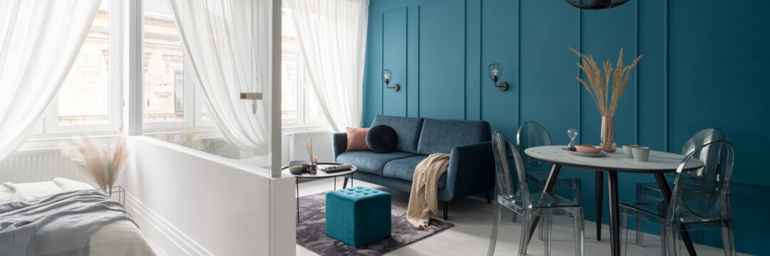 Living room with teal blue wall, panorama