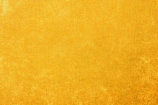 Yellow velvet texture, burgundy velor armchair as background, textile pattern