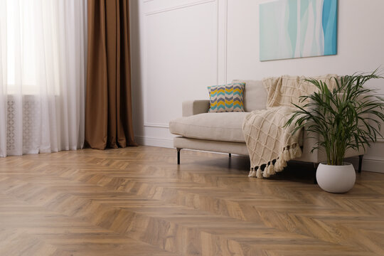 Modern living room with parquet flooring and stylish sofa