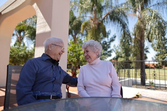 World War II veteran William Lloyd Roberts, 94, and his wife, Erma Lee Hanna Roberts, 91, sit on a patio, having received both doses of the coronavirus disease (COVID-19) vaccine at Mission Commons assisted living community in Redlands