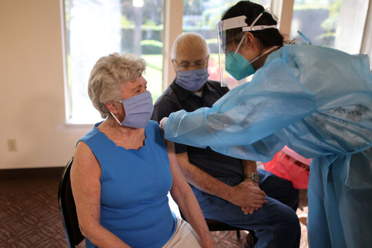 World War II veteran William Lloyd Roberts, 94, and his wife, Erma Lee Hanna Roberts, 91, receive the coronavirus disease (COVID-19) vaccine at Mission Commons assisted living community in Redlands