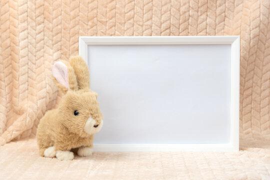 Stuffed animal toy bunny and white frame mockup