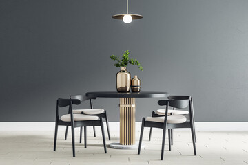 Black round table with wooden chairs around in the center of modern dining room with black wall and...