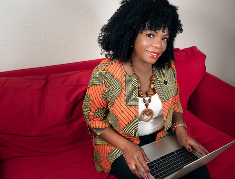 African American woman with a computer laptop at home