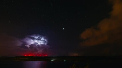 Wall Mural - Fantastic starry sky during a thunderstorm.