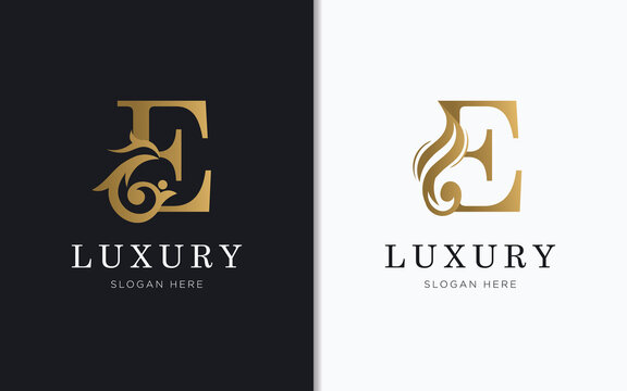 Luxury letter E with gold color logo template