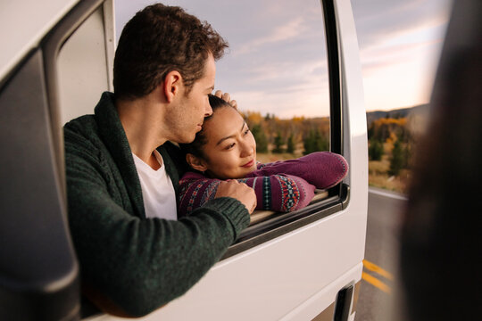 Couple leaning on RV door looking at view