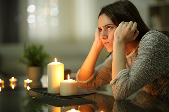 Angry homeowner using candles during power outage
