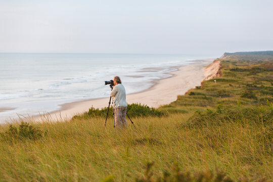 A photographer at the Marconi Station Site in the Cape Cod National Seashore. Wellfleet, Massachusetts.