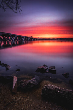 An intense sunrise in Alexandria looking across the Potomac River into Maryland, next to the Woodrow Wilson Bridge.