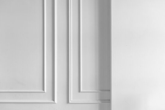 White wall with niche and decorative frame elements