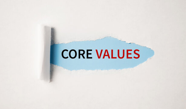 Core Values written behind torn paper. Business and ethics concept.