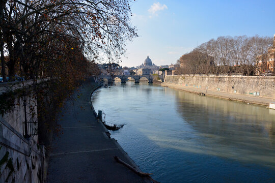 View of the St. Peter's Basilica and the Tiber river in Rome, Italy.