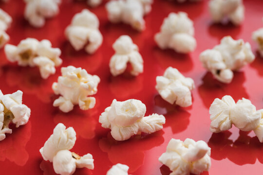 Closeup of some popcorn on a red background